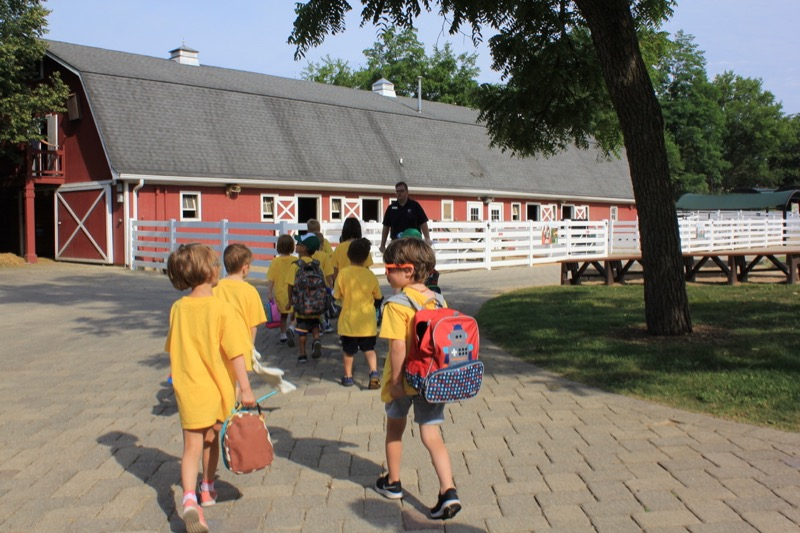 kids with backpacks participating in a program